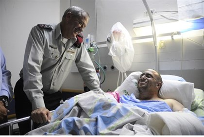 Benny Gantz visits Ziv Shilon as he recovers from Hamas attack