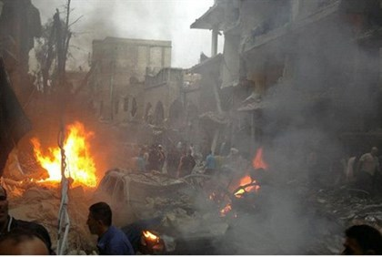Syrians inspecting the site of a car bomb attack