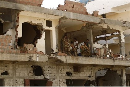 Soldiers in a building damaged during fighting with al Qaeda-terrorists in Zinjibar