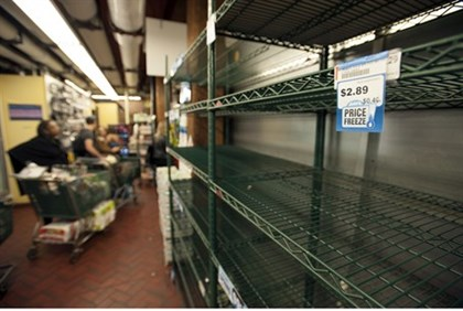 Empty grocery store shelves are a common sight as NYers prepare for Sandy