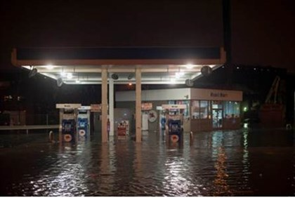 A gas station is submerged in floodwaters in Brooklyn