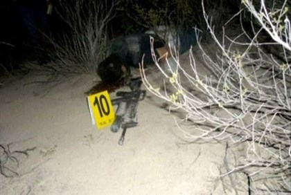 body of Zetas drug cartel founder Heriberto Lazcano at the site of his death in Sabinas