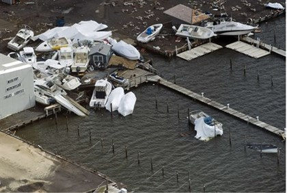 Boats pile up at a marina where they washed ashore during Hurricane Sandy