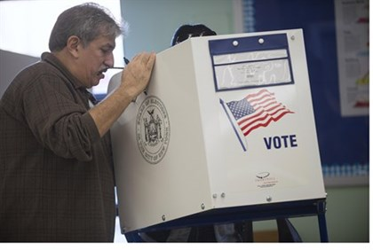 Poll worker helps voter in Staten Island, NY polling station