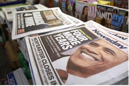 newspapers show Obama winning election