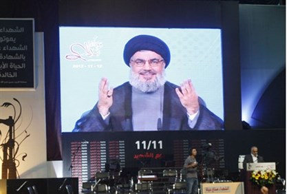 Sheikh Hassan Nasrallah on video link to a rally