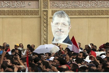 Supporters of Egyptian President Mursi chant slogans during a protest in Cairo