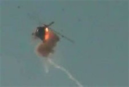 An image grab taken from YouTube allegedly shows a Syrian army helicopter being hit by a ground-to-a