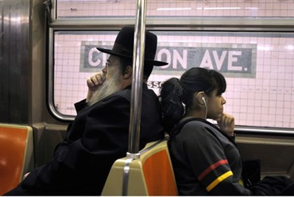 ultra orthodox Jewish man and secular woman on subway