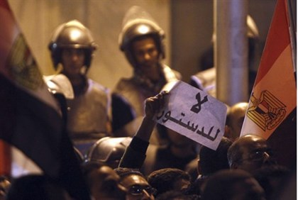 Egyptian police protect palace, sign reads 'No Constitution'
