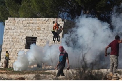 Arab  protester hurls stones at IDF during protest against Jewish community of  Halamish