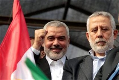 Hamas' Haniyeh (l), Islamic Jihad's Al-Hindi