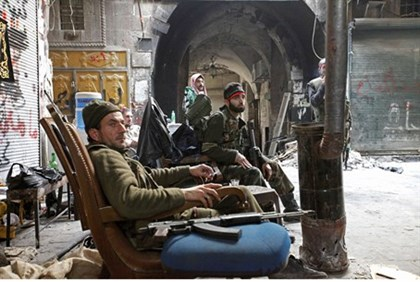 Free Syrian Army fighters rest in the old city of Aleppo