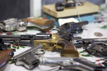 Handguns turned in are seen during a gun buyback event in Bridgeport, Connecticut, in the wake of th