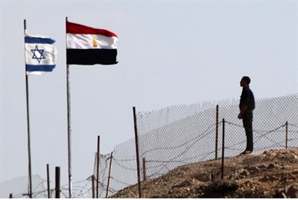 Egyptian soldier stands guard at the Taba crossing between Egypt and Israel