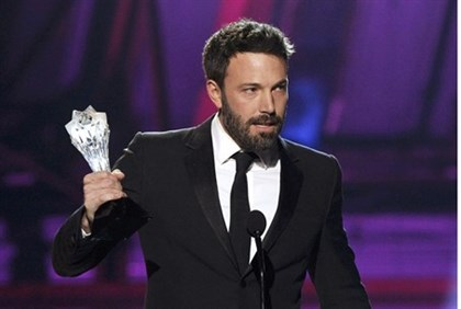 "Director Ben Affleck accepts the ""Best Director"" award for the movie ""Argo"" at the 2013 Critics' Cho"