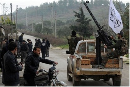 Syrian rebels patrol in the northwestern town of Jisr al-Shughur