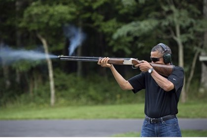 President Obama shoots clay targets on the range at Camp David