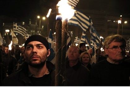 Golden Dawn supporters march through Athens