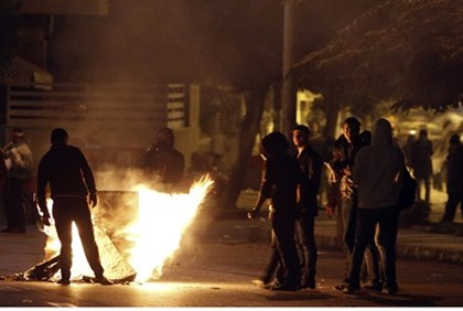 Anti-Morsi protesters during clashes with police in front of the presidential palace in Cairo