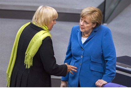 German Chancellor Merkel talking with the co-leader of opposition Green Party Claudia Roth