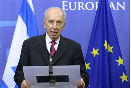 President Shimon Peres talks during a news conference with European Council President