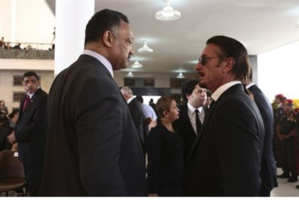Rev. Jesse Jackson (L) talks with actor Sean Penn during Chavez's funeral
