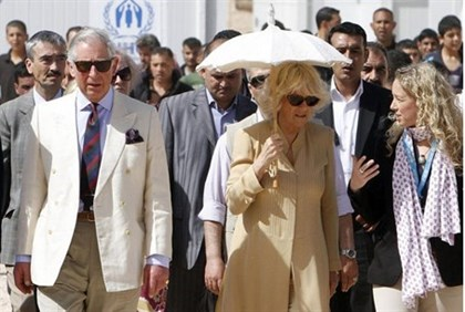 Britain's Prince Charles (L) and his wife Camilla