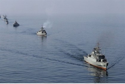Iranian Navy boats take part in navy maneuvers in the Strait of Hormuz