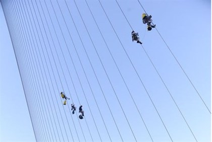 climbing the string bridge (archive)