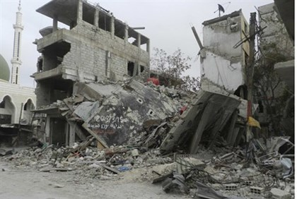 Damaged buildings after shelling near Damascus