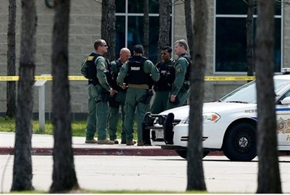 Police officers seal off Cyfair campus of Lone Star College after student stabs at least 14 people