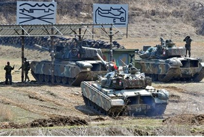 South Korean army tanks line up at a shooting range in the border city of Paju