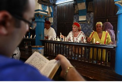 Jews pray inside the El Ghriba synagogue in Djerba