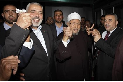 Hamas's Prime Minister Ismail Haniyeh and Yousef al-Qaradawi