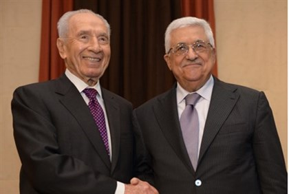 President Shimon Peres meets PA Chairman Mahmoud Abbas at the World Economic Forum in Jordan