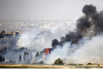 Smoke rises from Israel-Syria border