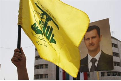 Hezbollah supporters show support for Assad