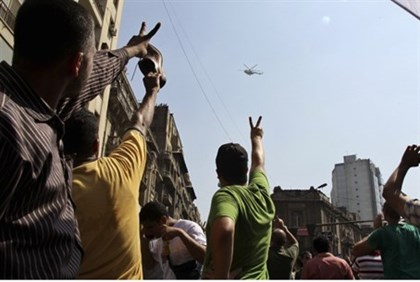 Egyptians gesturing at helicopter