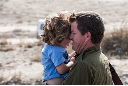 Illustration: IDF reservist arrives for duty with his son Nov. 2012