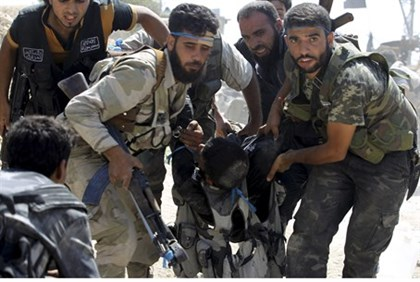 Syrian rebels carry wounded fighter in Aleppo, Sept. 21