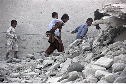 Survivors pick through the rubble in earthquake-hit Balochistan province in Pakistan
