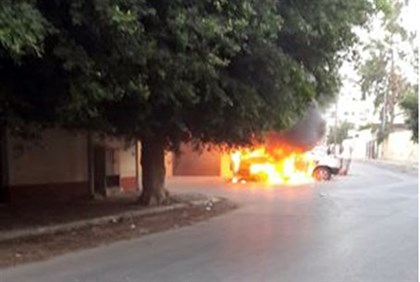 Burning car in front of the Russian embassy in Tripoli