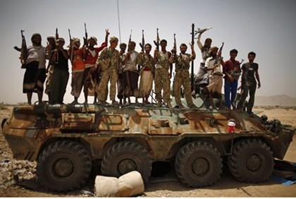 (Illustration) Yemeni armed forces celebrate after taking Al Qaeda positions