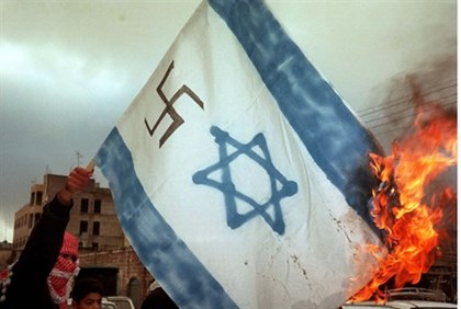 Anti-Israel demonstrators burn Israeli flag emblazoned with a swastika
