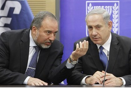 Liberman and Netanyahu at a faction meeting earlier this year