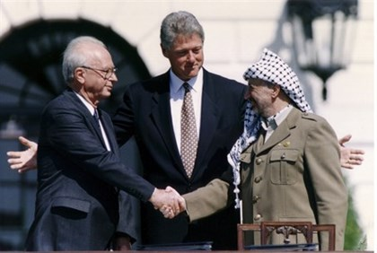 Yitzchak Rabin and Yasser Arafat shake hands at the signing of the Oslo Accords