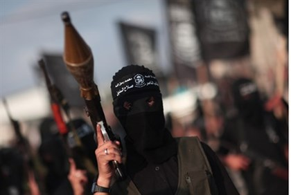 Popular Resistance Committee terrorists parade their weapons in Gaza