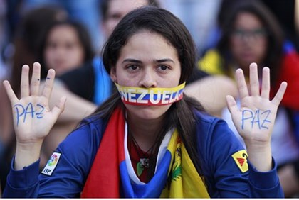 Venezuelan student at opposition rally in Caracas