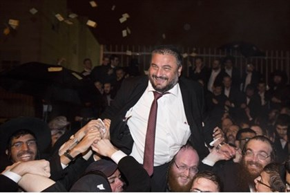 Incumbent Mayor Moshe Abutbul celebrates with supporters after winning re-vote Wednesday